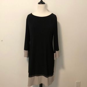 Very flattering Black Dress with detail bottom